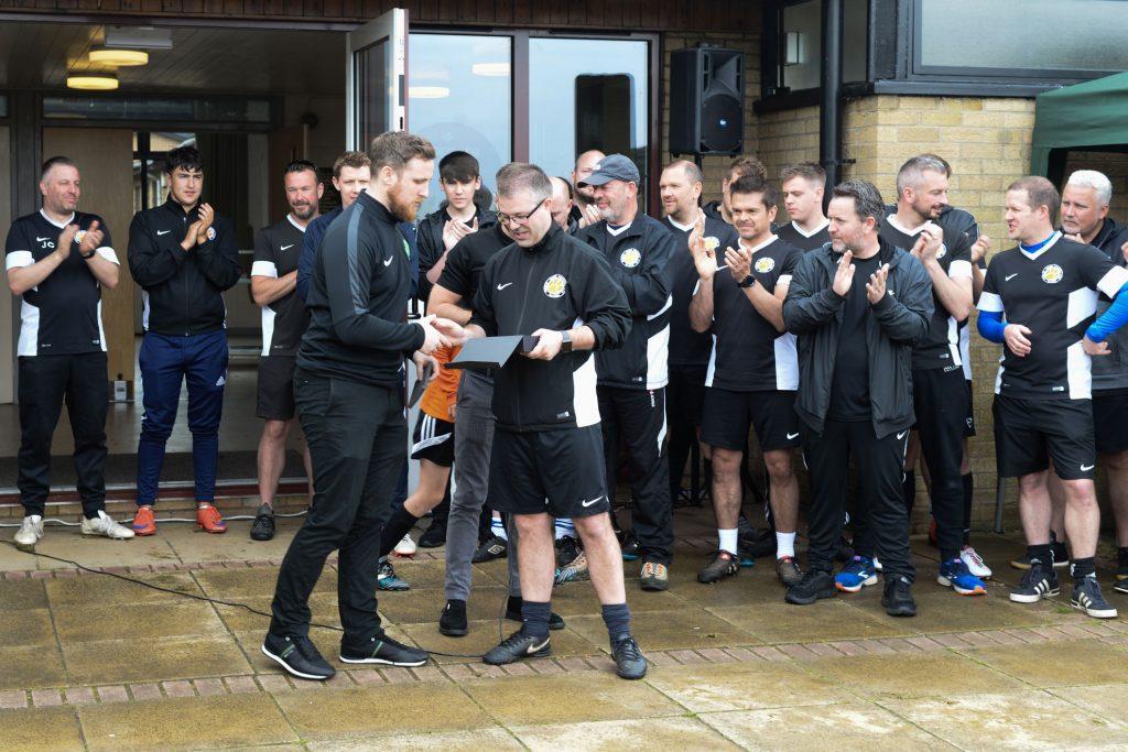 Club Secretary, Phil Davies, receives the FA Charter Standard Development Club award.